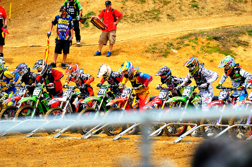 The start of the 250 class during the first moto of the Lucas Oil AMA Pro Motocross at Budds Creek National in Mechanicsville, Maryland on Saturday, June 18, 2011. Alan P. Santos/DC Sports Box