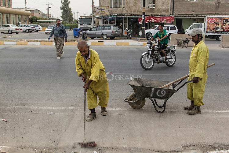 11/10/2014 -- Kirkuk, Iraq -- Two Bangladeshi workers clean the Shorja street.