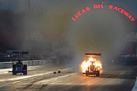 Aug. 31, 2012; Claremont, IN, USA: NHRA top fuel dragster driver Pat Dakin (right) has a fire alongside Keith Murt during qualifying for the US Nationals at Lucas Oil Raceway. Mandatory Credit: Mark J. Rebilas-