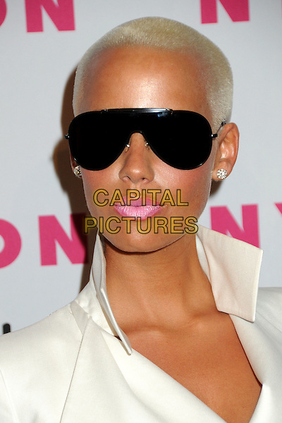 AMBER ROSE .Nylon Magazine's Young Hollywood Party held at the Roosevelt Hotel's Tropicana Bar,  Hollywood, California, USA, 12th May 2010..arrivals portrait headshot sunglasses aviators black pink lipstick make-up blonde shaved head white cream collar earrings diamond studs .CAP/ADM/BP.©Byron Purvis/AdMedia/Capital Pictures.