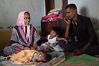 Rani Barukaum, the local SHG leader speaks with parent of a new born child in Ambedkar Nagar in Medak, Telangana, India.
