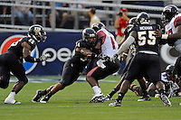 24 September 2011:  FIU linebacker Winston Fraser (34) tackles ULL quarterback Blaine Gautier (17) in the second quarter as the University of Louisiana-Lafayette Ragin Cajuns defeated the FIU Golden Panthers, 36-31, at FIU Stadium in Miami, Florida.