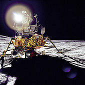 """A front view of the Apollo 14 Lunar Module """"Antares"""", which reflects a circular flare caused by the brilliant sun on February 5, 1971. The unusual ball of light was said by the astronauts to have a jewel-like appearance. At extreme left, the lower slope of Cone Crater can be seen.<br /> Credit: NASA via CNP"""