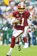 Landover, MD - September 23, 2018: Washington Redskins quarterback Alex Smith (11) runs for a first down during the  game between Green Bay Packers and Washington Redskins at FedEx Field in Landover, MD.   (Photo by Elliott Brown/Media Images International)