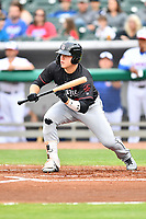 Birmingham Barons first baseman Gavin Sheets (24) squares to bunt during a game against the Tennessee Smokies at Smokies Stadium on May 15, 2019 in Kodak, Tennessee. The Smokies defeated the Barons 7-3. (Tony Farlow/Four Seam Images)