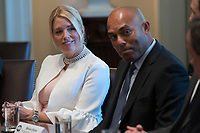 Florida Attorney General Pam Bondi (L) and former New York Yankee great Mariano Rivera (R) listen as US President Donald J. Trump delivers remarks during an opioid and drug abuse listening session in the Roosevelt Room of the White House in Washington, DC, USA, 29 March 2017. Photo Credit: Shawn Thew/CNP/AdMedia