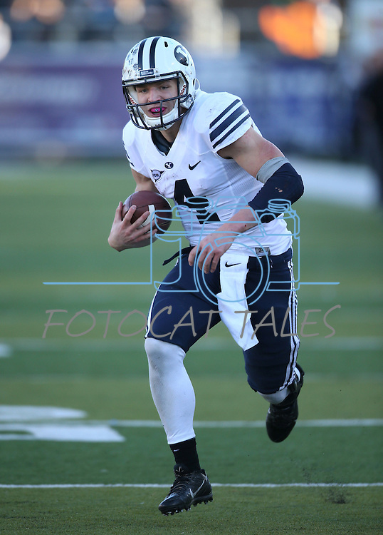 BYU quarterback Taysom Hill (4) runs up the middle in an NCAA college football game against Nevada, in Reno, Nev., on Saturday, Nov. 30, 2013. BYU defeated Nevada 28-23. (AP Photo/Cathleen Allison)