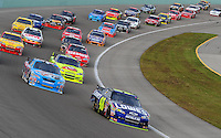 Nov. 22, 2009; Homestead, FL, USA; NASCAR Sprint Cup Series driver Jimmie Johnson (48) leads the field during the Ford 400 at Homestead Miami Speedway. Mandatory Credit: Mark J. Rebilas-