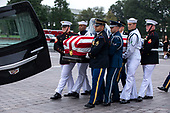 Joint service members of a military casket team carry the casket of Senator John McCain from the US Capitol to a motorcade that will ferry him to a funeral service at the National Cathedral in Washington, DC, USA, 01 September 2018. McCain died 25 August, 2018 from brain cancer at his ranch in Sedona, Arizona, USA. He was a veteran of the Vietnam War, served two terms in the US House of Representatives, and was elected to five terms in the US Senate. McCain also ran for president twice, and was the Republican nominee in 2008.<br /> Credit: Jim LoScalzo / Pool via CNP