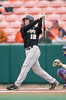 Carlos Lopez #12 of the Wake Forest Demon Deacons follows through on his swing versus the Clemson Tigers at Doug Kingsmore stadium March 13, 2009 in Clemson, SC. (Photo by Brian Westerholt / Four Seam Images)