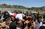 Mourners carry the body of Palestinian Ziad al-Barim, 25, who was shot dead by Israeli troops during clashes at Israel-Gaza border, during his funeral in Khan Younis in the southern Gaza strip on June 9, 2018. Four Palestinians were killed by Israeli fire on the Gaza border on June 8, the territory's health ministry said giving a new toll, as weeks of deadly clashes with protesters continued. Photo by Ashraf Amra