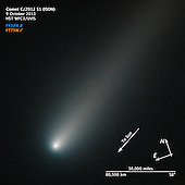 A new image of the sunward plunging Comet ISON suggests that the comet is intact despite some predictions that the fragile icy nucleus might disintegrate as the Sun warms it. The comet will pass closest to the Sun on November 28.  In this NASA Hubble Space Telescope image taken on October 9, the comet's solid nucleus is unresolved because it is so small. If the nucleus broke apart then Hubble would have likely seen evidence for multiple fragments. Moreover, the coma or head surrounding the comet's nucleus is symmetric and smooth. This would probably not be the case if clusters of smaller fragments were flying along. What's more, a polar jet of dust first seen in Hubble images taken in April is no longer visible and may have turned off. The tail forms as dust particles are pushed away from the nucleus by the pressure of sunlight. The comet was inside Mars' orbit and 177 million miles from Earth when photographed. Comet ISON is predicted to make its closest approach to Earth on December 26, at a distance of 39.9 million miles.<br /> Credit: NASA-STScI via CNP