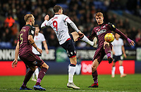 Bolton Wanderers' Christian Doidge competing with Swansea City's Jay Fulton<br /> <br /> Photographer Andrew Kearns/CameraSport<br /> <br /> The EFL Sky Bet Championship - Bolton Wanderers v Swansea City - Saturday 10th November 2018 - University of Bolton Stadium - Bolton<br /> <br /> World Copyright © 2018 CameraSport. All rights reserved. 43 Linden Ave. Countesthorpe. Leicester. England. LE8 5PG - Tel: +44 (0) 116 277 4147 - admin@camerasport.com - www.camerasport.com
