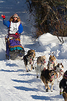 Musher Michelle Phillips on Long Lake at the Re-Start of the 2011 Iditarod Sled Dog Race in Willow, Alaska.