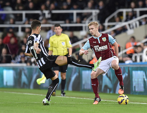 01.01.2015.  Newcastle, England. Barclays Premier League. Newcastle versus Burnley.  Ayoze Perez of Newcastle United challenges Ben Mee of Burnley