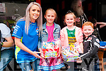 Poker Run : Pulmonary Fibrosis sufferer Michael Beazley, 8 years old, right& Hanah  McGrath making a presentation to his classmates Emma & Grace Heffernan, who raised €3000.00 for the fund playing music in front of Super Value , Ballybunion & Listowel   prior to the start of the poker to raise funds to buy lighter equipment for him to carry at Flannagan's Bar , Listowel on Sunday last.