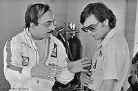 Bobby Rahal speaks with Maurizio DeNarveaz in the pit lane during the 1982 12 Hours of Sebring IMSA race in Sebring, Florida, USA.