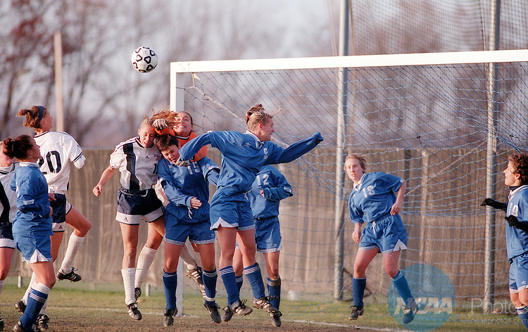 22 NOV 1998: Macalester College goalie Anna Bacho (#0) reaches over her teammate Ellen Dully (#15) for the ball as the College of New Jersey tries for a goal during the Women's Division III Soccer Championship held at Ithaca College in Ithaca, NY. Macalester defeated New Jersey 1-0 in the second sudden death overtime period of the game. Nick Lisi/NCAA Photos