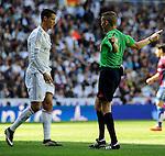 Real Madrid´s Cristiano Ronaldo and referee Alejandro Jose Hernandez during 2014-15 La Liga match between Real Madrid and Eibar at Santiago Bernabeu stadium in Madrid, Spain. April 11, 2015. (ALTERPHOTOS/Luis Fernandez)