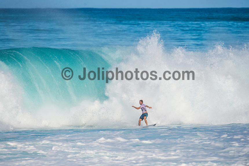 BANZAI PIPELINE, Oahu/Hawaii (Friday, December 12, 2014) Adam Melling (AUS). - The final stop of the 2014  World Championship Tour, the Billabong Pipe Masters in Memory of Andy Irons, was  called ON today in double overhead surf. <br /> <br /> Competition began with the final of Men's Pipe Masters Invitational. It had been a 32-man event comprising of local Pipe specialists competing for a US$100,000 prize purse as well as two wildcard positions in the Billabong Pipe Masters. <br /> Reef MacIntosh (HAW) and Makai McNamara (HAW) who moved into the main event.<br /> IN the World Title showdown both Mick Fanning (AUS) and Gabriel Medina (BRA) won their heats today  and moved straight into Round 3 while Kelly Slater (USA) lost his heat and will have to surf in the sudden death Round 2.<br /> The Billabong Pipe Masters in Memory of Andy Irons will determine this year&rsquo;s world surfing champion as well as those who qualify for the elite tour in 2015. As the third and final stop on the Vans Triple Crown of Surfing Series  the event will also determine the winner of the revered three-event leg.<br /> <br /> The ASP Heritage Series, which celebrates the rich culture and history of professional surfing, had it's third and final competitive event of the season today with a four-man heat between Gary Elkerton (AUS), Tom Carroll (AUS), Derek Ho (HAW) and Sunny Garcia (HAW). Carroll dominated the final with Garcia in 2nd , Ho  3rd and Elekerton 4th.<br /> <br /> The world&rsquo;s best female surfers also competed at Pipeline this afternoon in the Women&rsquo;s Pipe Masters Invitational with reigning six-time  Women&rsquo;s World Champion Stephanie Gilmore (AUS) finished in 4th while two-time Women&rsquo;s World Champion Carissa Moore (HAW) easily won the heat., Australian powerhouse Tyler Wright (AUS) was 2nd and international icon Bethany Hamilton (HAW)  finished 3rd. Photo: joliphotos.com