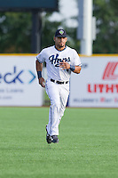 Gerard Hernandez (4) of the Hillsboro Hops runs in the outfield prior to a game against the Tri-City Dust Devils at Ron Tonkin Field in Hillsboro, Oregon on August 24, 2015.  Tri-City defeated Hillsboro 5-1. (Ronnie Allen/Four Seam Images)