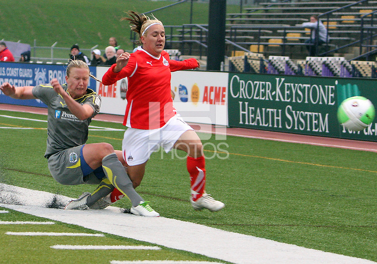 Sara Larrson #7 of the Philadelphia Independence knocks the ball away from Lisa De Vanna #11 of the Washington Freedom during a WPS match on April 25 2010, at John A. Farrell Stadium, in West Chester, Pennsylvania.