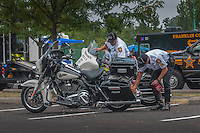 Reynoldsburg police officers clean their motorcycles of kids fingerprints and dirt following Cops and Kids Day, an event where children get to talk with officers, touch police equipment, and see safety equipment used by police and fire fighters.