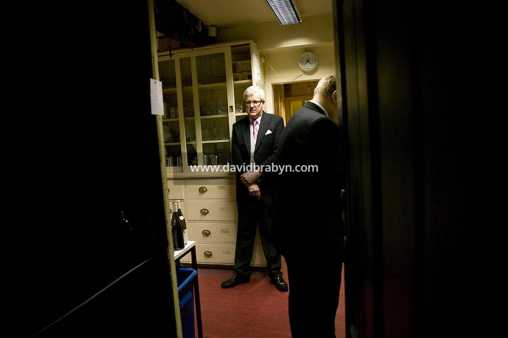 College Butler Gary Love (L)waits in his pantry the start of formal dinner at Magdalene College in Cambridge, United Kingdom, 11 March 2007.