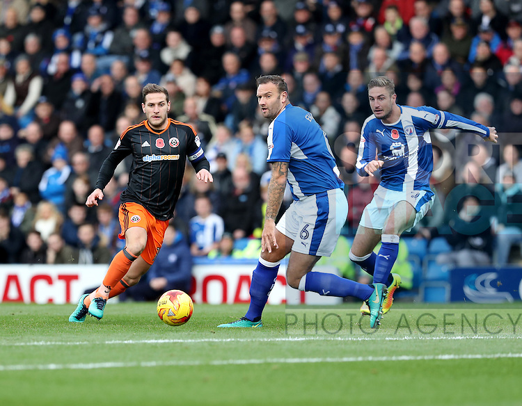 Billy Sharp of Sheffield United passes beyond Ian Evatt of Chesterfield during the English Football League One match at Proact Stadium, Chesterfield. Picture date: November 13th, 2016. Pic Jamie Tyerman/Sportimage