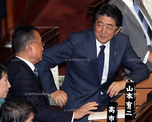 November 10, 2016, Tokyo, Japan - Japanese Prime Minister Shinzo Abe (R) smiles with Agriculture Minister Yuji Yamamoto after Yamamoto's no-confidence motion was voted down at the Lower House plenary session at the National Diet in Tokyo on Thursday, November 10, 2016. The no-confidence motion brought by opposition parties for Yamamoto's verbal gaffes was voted down by ruling parties.  (Photo by Yoshio Tsunoda/AFLO) LWX -ytd-