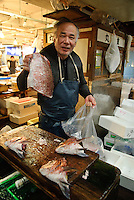 Portraits of people who work at Tsukiji fish market, Tokyo, Japan, November 16, 2007. The Tokyo Metropolitan Central Wholesale Market, better known as Tsukiji market, is the largest fish market in the world. Tsukiji is both a popular tourist attraction and a Mecca of Japanese food culture.