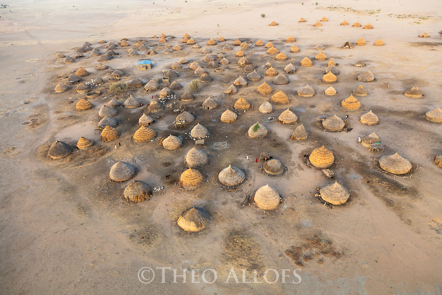 Chad (Tchad), North Africa, Sahara, aerial view of traditional village with round reed and mud huts north of Lake Fitri