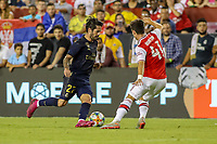 Landover, MD - July 23, 2019: Real Madrid Isco (22) is being defended by Arsenal Robbie Burton (41) during the match between Arsenal and Real Madrid at FedEx Field in Landover, MD.   (Photo by Elliott Brown/Media Images International)