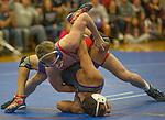 Spanish Springs Cougars Dustin Congdon, bottom, wrestles Reno Huskies Matthew Barnard in the 132 pound weight class on Wednesday night, January 13, 2016 at Reno High School.