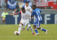 Kenny Cunningham (8) of Costa RIca goes against Marvin Chavez (17) of Hounduras.  Honduras defeated Costa Rica 1-0 at the quaterfinal game of the Concacaf Gold Cup, M&T Stadium, Sunday July 21 , 2013.