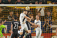 CARSON, CA - SEPTEMBER 15: Dave Romney #4 of the Los Angeles Galaxy heads a ball during a game between Sporting Kansas City and Los Angeles Galaxy at Dignity Health Sports Complex on September 15, 2019 in Carson, California.