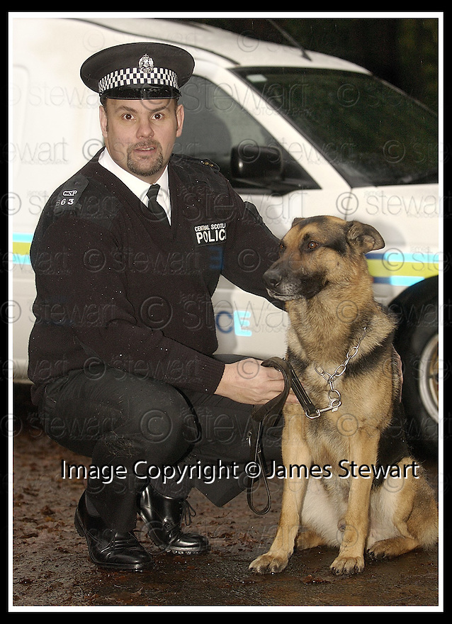 30/11/02       Copyright Pic : James Stewart                  .File Name : stewart-brave cop 03.CENTRAL SCOTLAND POLICE CONSTABLE  GEORGE LEWANDOWSKI WHO HAS BEEN AWARDED HIS SECOND BRAVERY AWARD IN A YEAR FOR TACKLING A SUSPECTED ARMED MAN..... HE IS PICTURED WITH HIS POLICE DOG JACK......James Stewart Photo Agency, 19 Carronlea Drive, Falkirk. FK2 8DN      Vat Reg No. 607 6932 25.Office : +44 (0)1324 570906     .Mobile : + 44 (0)7721 416997.Fax     :  +44 (0)1324 570906.E-mail : jim@jspa.co.uk.If you require further information then contact Jim Stewart on any of the numbers above.........
