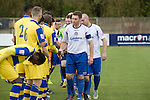 Vauxhall Motors FC 0 Solihull Moors 2, 26/04/2014. Rivacre Park, Conference North. The two teams exchanging handshakes before Vauxhall Motors (in white) play Solihull Moors at Rivacre Park in the final Conference North fixture of the season. It was to be the last match for the Ellesmere Port-based home club, named after the giant car factory in the town, who have resigned from the professional pyramid system to return to local amateur football due to spiralling costs and low attendances. Their final match resulted in a 2-0 home defeat, watched by a crowd of only 215. Photo by Colin McPherson.