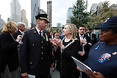 On the 10th anniversary of the September 11th terrorist attacks, United States Secretary of State Hillary Rodham Clinton (right), wife of former U.S. President Bill Clinton, with Sergeant Craig Lourich of the New York State Court Officers, at opening day of the September 11th Memorial at the World Trade Center site in New York, New York on September 11, 2011. Lourich escaped the collapse of Tower 1. Three court officers died on 9/11..Credit: Jefferson Siegel / Pool via CNP