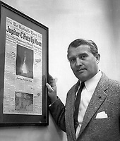 1963-01-01 File Photo<br /> Dr. von Braun is presented with the front page of the Huntsville Times arnouncing the launch of Explorer I, the first U.S. Earth satellite, which was boosted by the Jupiter-C launch vehicle developed by Army Ballistic Missile Agency (ABMA) under the direction of Dr. von Braun. The occasion was the fifth Anniversary of the Explorer I launch in January 1958.
