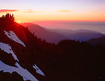 Olympic National Park, WA  <br /> Sun setting behind Hurricane Hill with distant ridges descending down to the waters of the Strait of Juan De Fuca