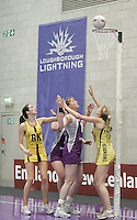 04 MAY 2007 - LOUGHBOROUGH, UK - Alex Astle watches to see if she has scored - Loughborough Lightning (Purple) v Northern Thunder (Yellow). (PHOTO (C) NIGEL FARROW)