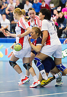 22 OCT 2011 - LONDON, GBR - Britain's Nina Heglund (#05 / in blue and red) finds her way to goal blocked by (from the left) Russia's Polina Gorshkova (#32 - white), Viktoriya Zhilinskayte (#21 - white) and Liudmila Bodnieva (#07 - white) during the Women's 2012 European Handball Championship qualification match between the two teams at the National Sports Centre at Crystal Palace .(PHOTO (C) NIGEL FARROW)