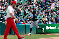 Reno Aces right fielder Abraham Almonte (7) rounds the bases after hitting a home run off Brady Dragmire (17) during a game against the Fresno Grizzlies at Chukchansi Park on April 8, 2019 in Fresno, California. Fresno defeated Reno 7-6. (Zachary Lucy/Four Seam Images)
