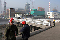 Workers take their lunch break outside a steel factory in Zhongyang, Shanxi province, China, on November 16, 2007. China's rate of birth defects had risen from 104.9 per 10,000 births in 2001, to 145.5 in 2006, China's National Population and Family Planning Commission said in a report on its web site (www.chinapop.gov.cn). China's coal-rich northern province of Shanxi, a centre of noxious emissions from large-scale coke and chemical industries, had the highest rate of birth defects, Xinhua news agency said. Photo by Lucas Schifres/Pictobank