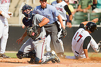 Rome Braves catcher Cory Brownsten #30 can't handle a throw to the plate as Ross Wilson #17 of the Kannapolis Intimidators scores a run at CMC-Northeast Stadium on May 28, 2012 in Kannapolis, North Carolina.  The Intimidators defeated the Braves 6-4.  (Brian Westerholt/Four Seam Images)