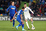 Getafe CF's Nemanja Maksimovic (l) and Damian Suarez (c) and FC Krasnodar's Younes Namli during UEFA Europa League match. December 12,2019. (ALTERPHOTOS/Acero)