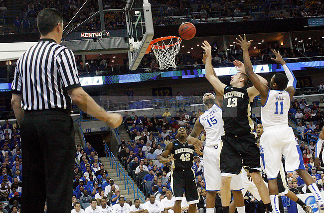Freshmen John Wall and DeMarcus Cousins guard Chas Macfarland during the first half of UK's second round  win over Wake Forest in the NCAA tournament at New Orleans Arena on Saturday, March 20, 2010. Photo by Britney McIntosh | Staff