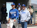 Western Nevada College's Joey Crunkilton escorts his dad onto the field for Sophomore Day festivities at John L. Harvey field, on Sunday, April 27, 2014, in Carson City, Nev.<br /> Photo by Cathleen Allison/Nevada Photo Source