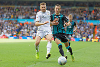 LEEDS, ENGLAND - AUGUST 31: (L-R) Stuart Dallas of Leeds United challenges Bersant Celina of Swansea City during the Sky Bet Championship match between Leeds United and Swansea City at Elland Road on August 31, 2019 in Leeds, England. (Photo by Athena Pictures/Getty Images)